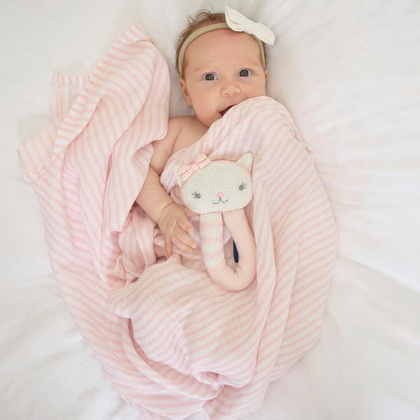 Baby-girl-cat-rattle-and-blush-stripe-muslin-swaddle-wrap-web-grande